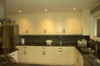A uniform look of equal sized doors and drawers make this kitchen simple, yet extremely elegant.