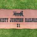 Garden sign engraved train picture and house number