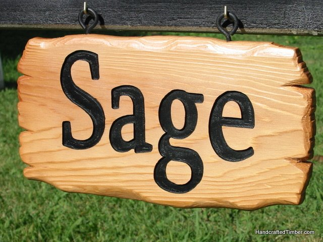 Close up of wooden name sign for dog kennel