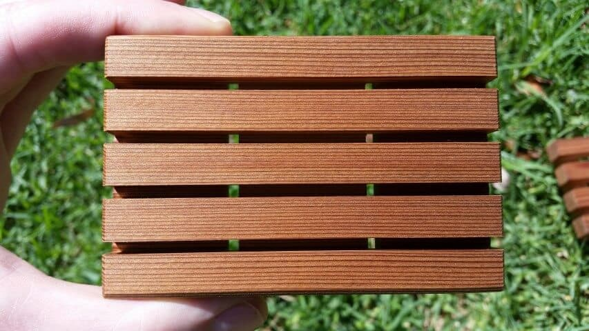 close up of wooden soap holder drain holes