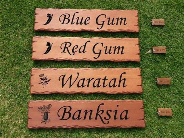 Cedar signs carved and engraved with Australian tree names, bush flowers and matching key rings for an Airbnb retreat