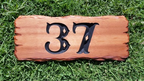 wooden house number sign for letter boxes reads numbers 37