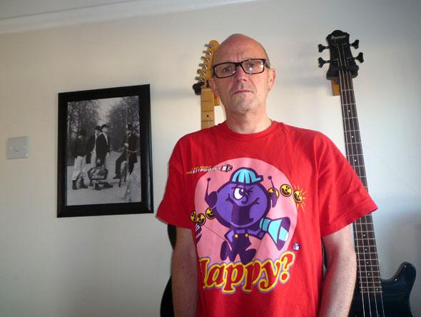 Frank looking happy in his Pop Will Eat Itself bulletproof 'Happy' T-shirt