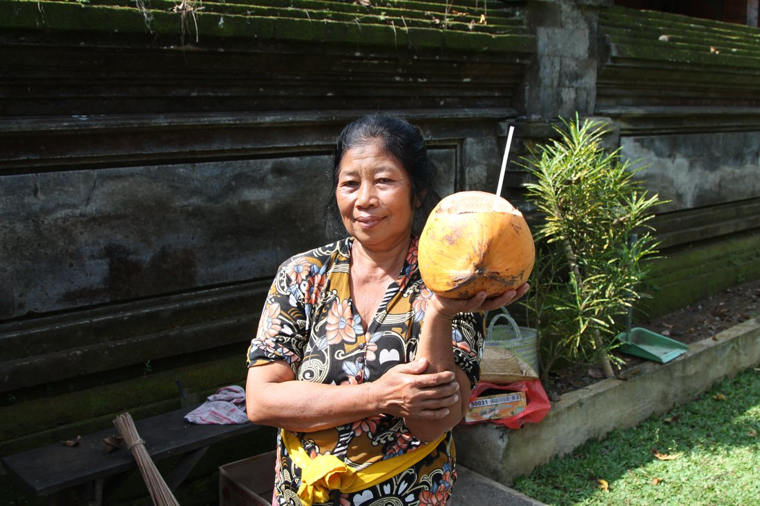 The Woman and The Coconut in Goa Gajah Temple, Bali, Indonesia (4)