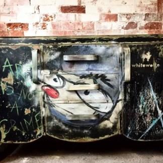 graffitied vintage sidebaord