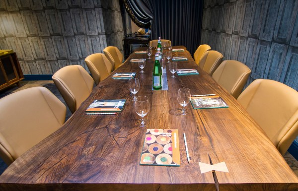 Live-edge two slab English Walnut meeting table, Kensington London