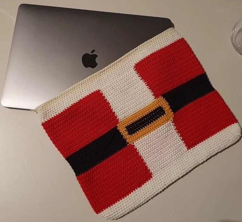 Santa's sleeve with laptop inside