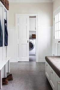 Organized entryway with custom cabinet lockers and seating area
