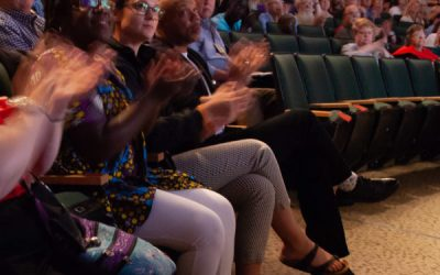 Presbyterians put their hands together and stomp their feet for the Hands and Feet initiative at a concert by jazz musician Kirk Whalum
