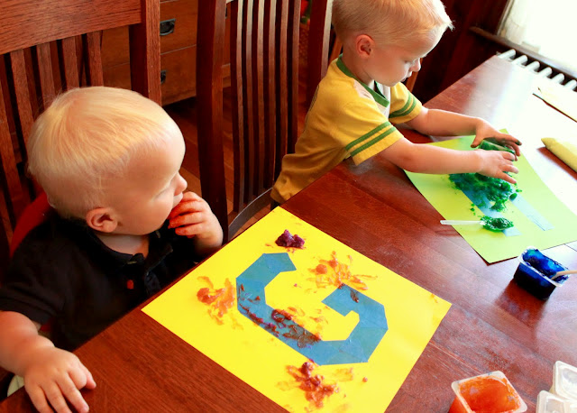 Tape resist painting using homemade edible finger paints