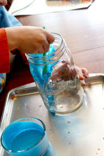 Paint the mason jars with colored glue. It's such a creative painting activity for kids!