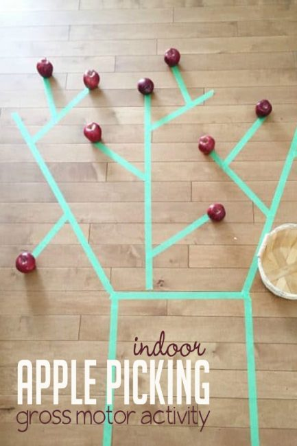 An indoor apple picking activity that's great for gross motor skills