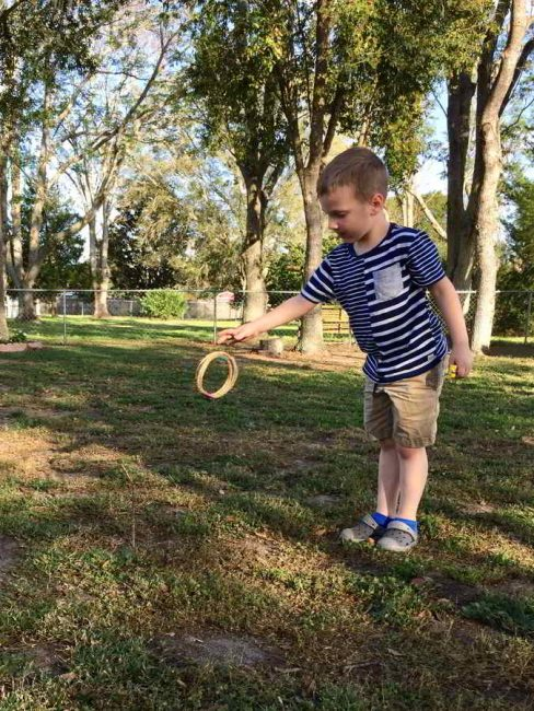 Make this simple DIY ring toss game! This outdoor play idea is simple and fun!