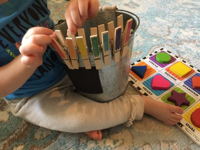 Explore color matching with a clothespin game for toddlers!