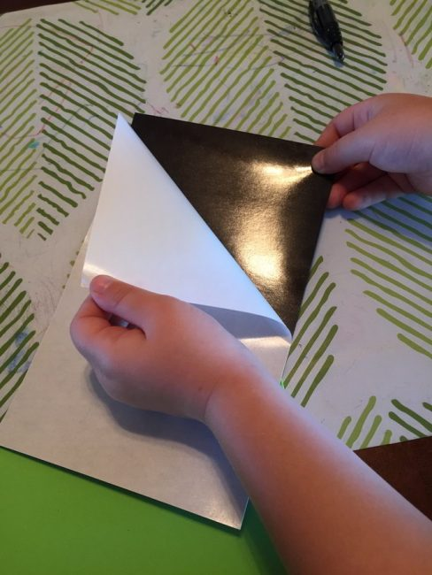 Peel the paper off the magnet - it's great for fine motor skills!