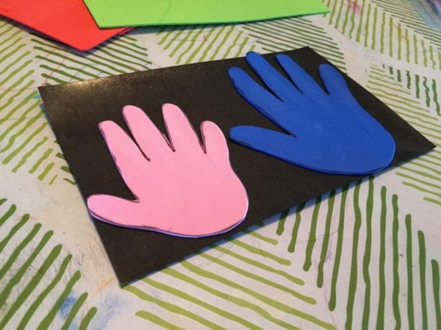 Add magnetic sheets to the back of your handprints.