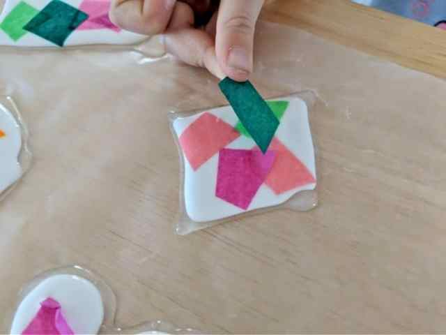 Squishing tissue paper into glue is a fun sensory experience!