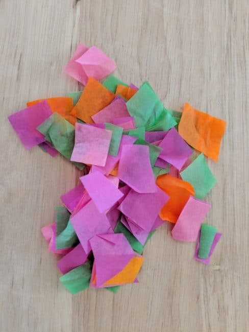 Use tissue paper to add a pop of color to your Mother's Day necklace craft.