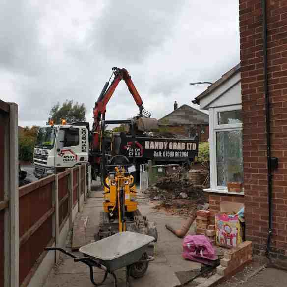 Mini Digger Hire.  In this picture is a mini Digger and grab wagon