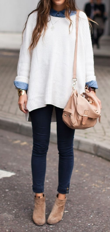 woman wearing a white oversized sweater with tan boots for a fall capsule wardrobe