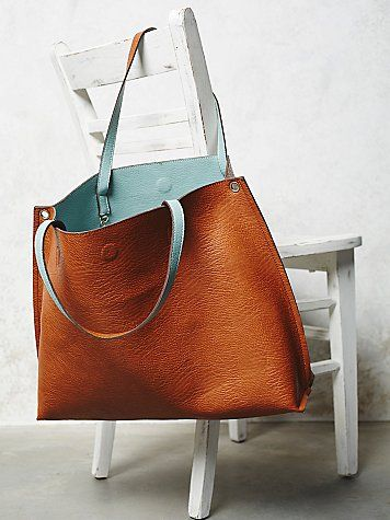 tan leather tote bag with turquose interior