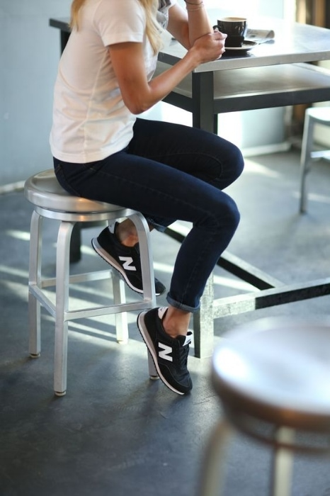 woman wearing new balance navy trainers