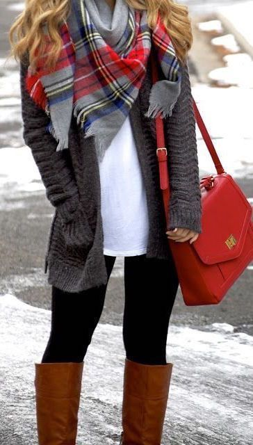 woman wearing a casual winter outfit with a plaid scarf
