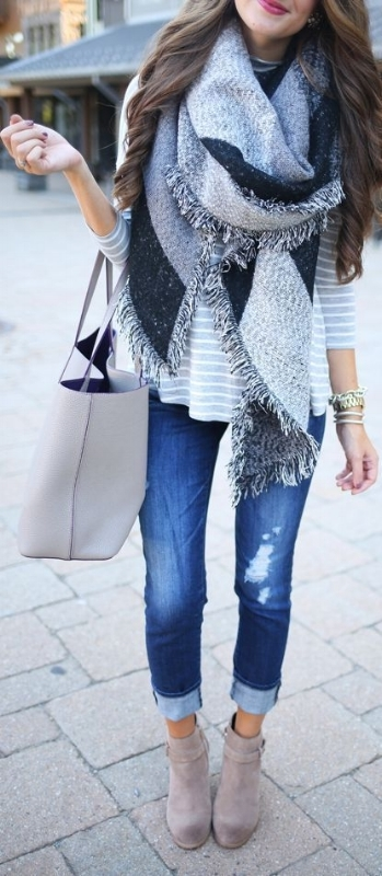 woman wearing a huge grey scarf and tan boots outfit