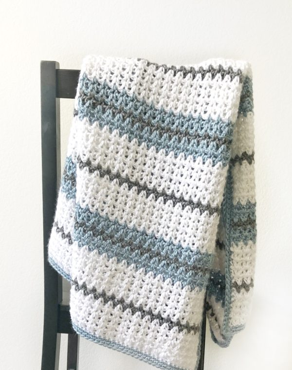 crochet blanket draped over a chair