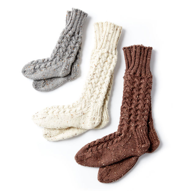 Cable knit socks in three sizes and various colours