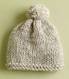 knitted hat with pom pom pattern