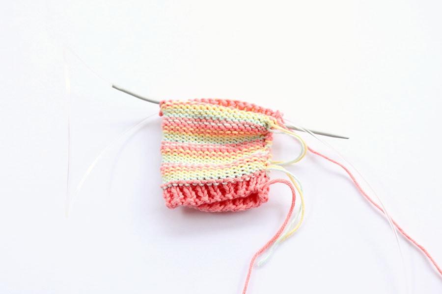 baby socks on needle
