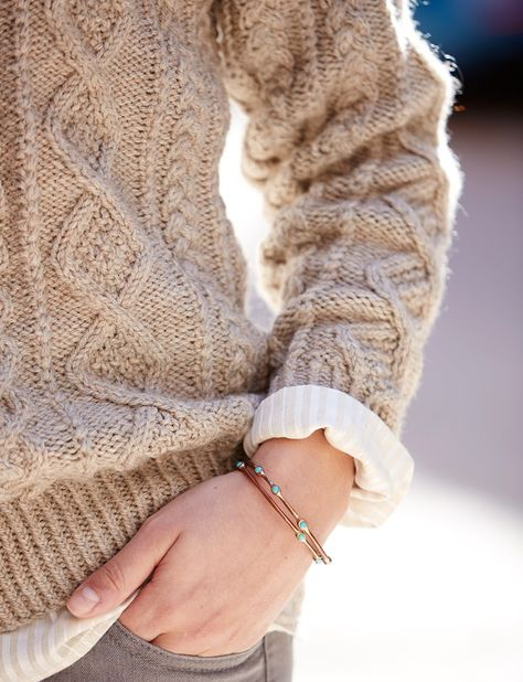 Close up detail of an intricate cable knit sweater