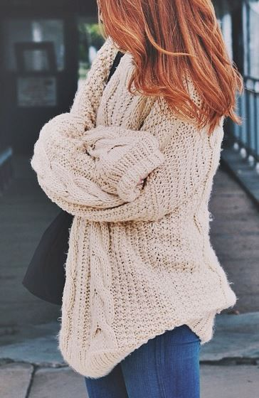 Girl wearing an oversized cable knit sweater