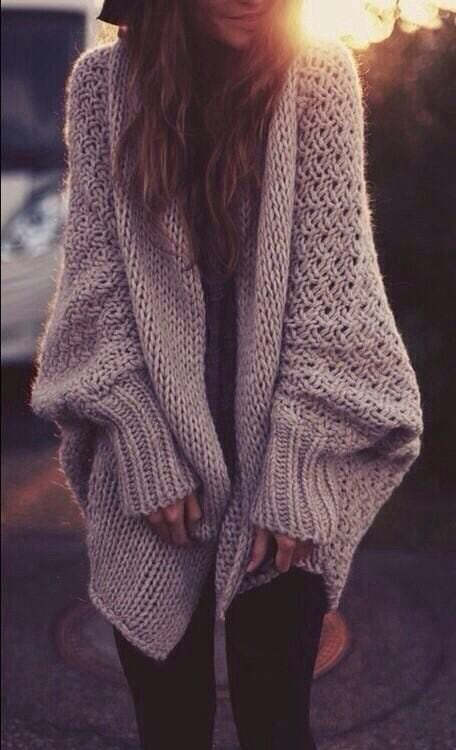 Girl wearing an oversized knit cardigan