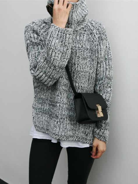 Girl wearing a grey knitted oversized sweater