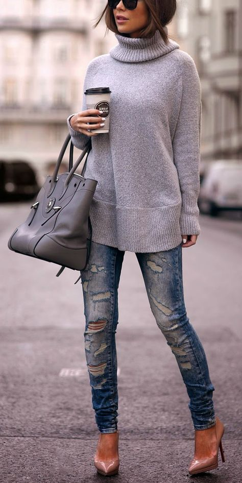 Girl wearing a large grey oversized sweater