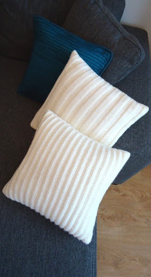 knitted pillows in ribbed patterns