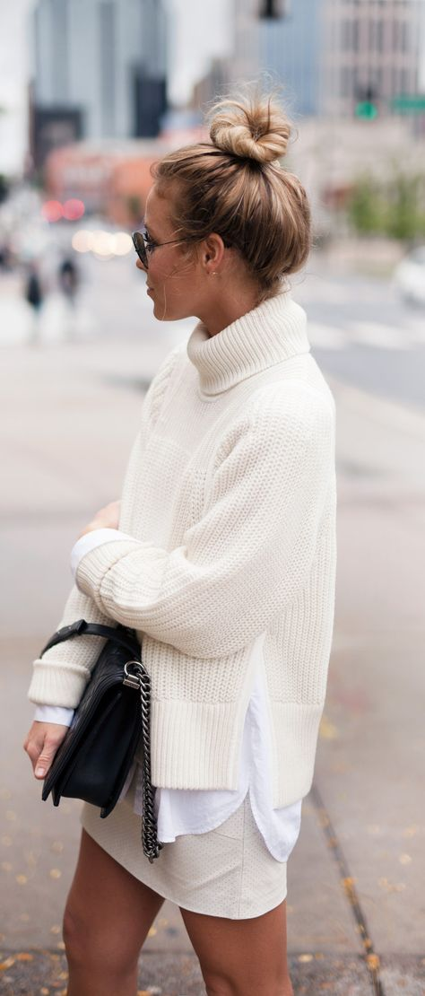 Girl wearing a white turtleneck oversized knit sweater