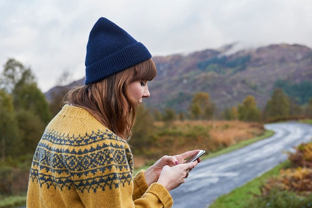 girl wearing a fair isle sweater and mariners hat