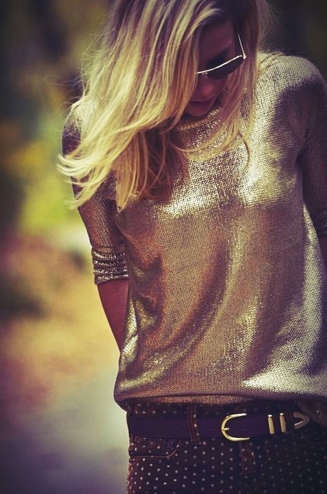 Girl wearing a gold sweater