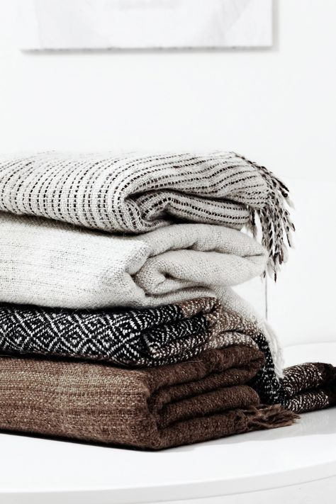 stacked blankets and throws for fall