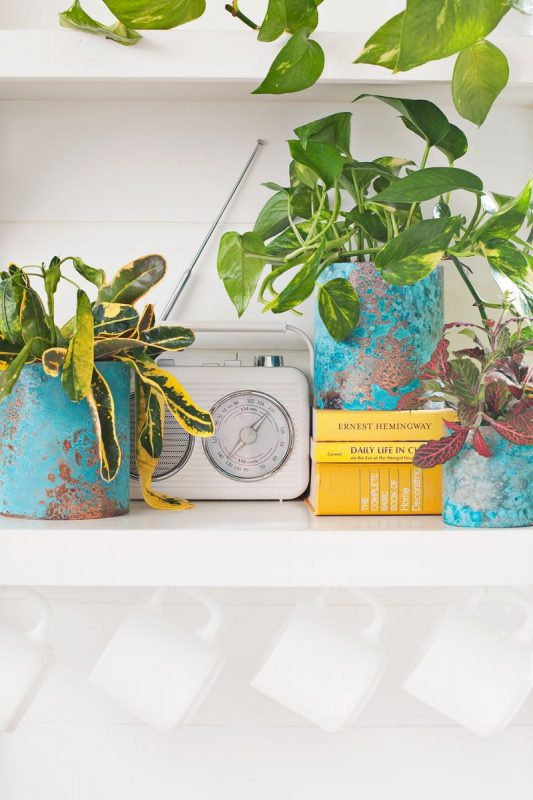 turquoise and copper planters on a shelf
