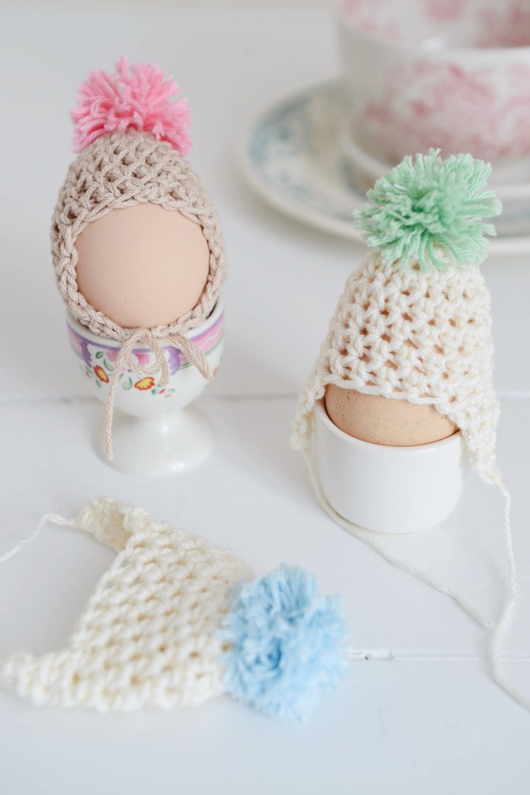 eggs wearing crochet hats and bonnets
