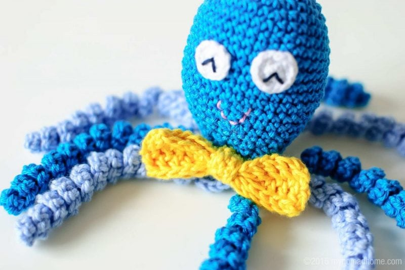crochet octopus wearing a bow tie