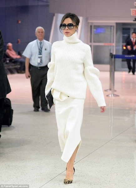 Victoria Beckham wearing a white turtleneck oversized sweater