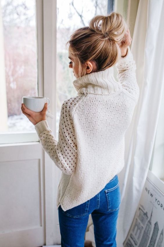 woman wearing a white knitted sweater