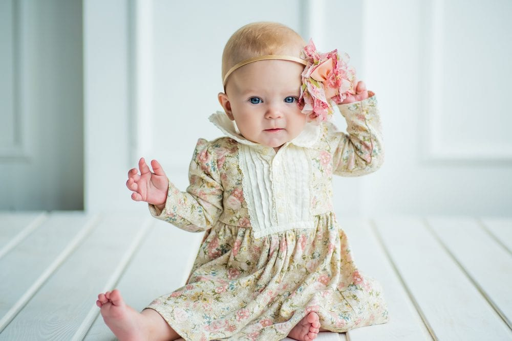 baby wearing a floral dress