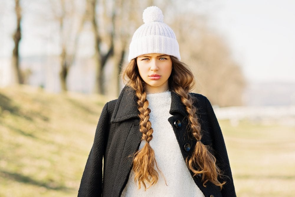 girl wearing white beanie hat