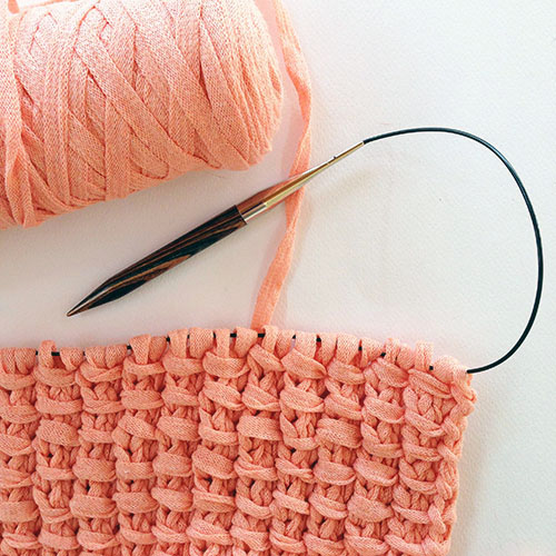 Peach mixtape yarn knitted to make the bamboo stitch